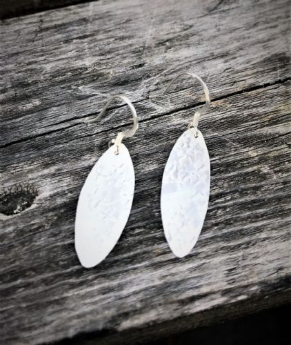Handmade hammered silver almond earrings